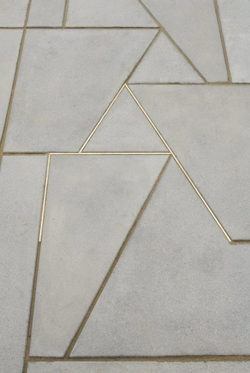 concrete-inlaid-with-brass