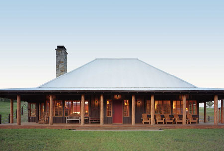 neat-roof-elevation-and-simplicity-of-this-texas-ranch-house-the-wrap-around-porch-is-perfect.