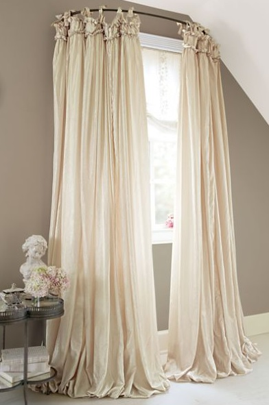 Use shower curtain to lend the windows a bigger look